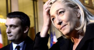 President of French far-right party Front national (FN), Marine Le Pen (R) next to her  vice-President, Florian Philippot, answers to journalists questions as she leaves the Elysee Palace in Paris, after a meeting with French President Francois Hollande, on November 30, 2012.     AFP PHOTO BERTRAND GUAY